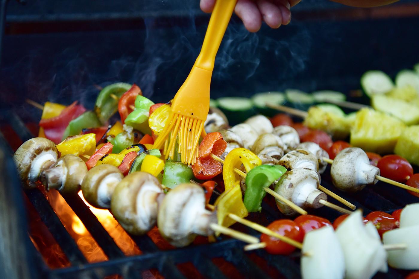 Brushing marinade on kebabs
