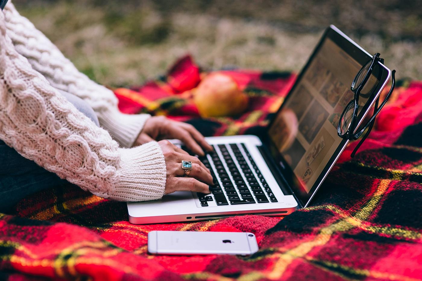 Entrepreneur using laptop on rug